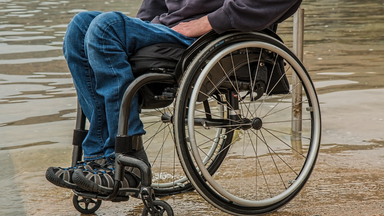 A person in a wheelchair who suffered a personal injury disability.
