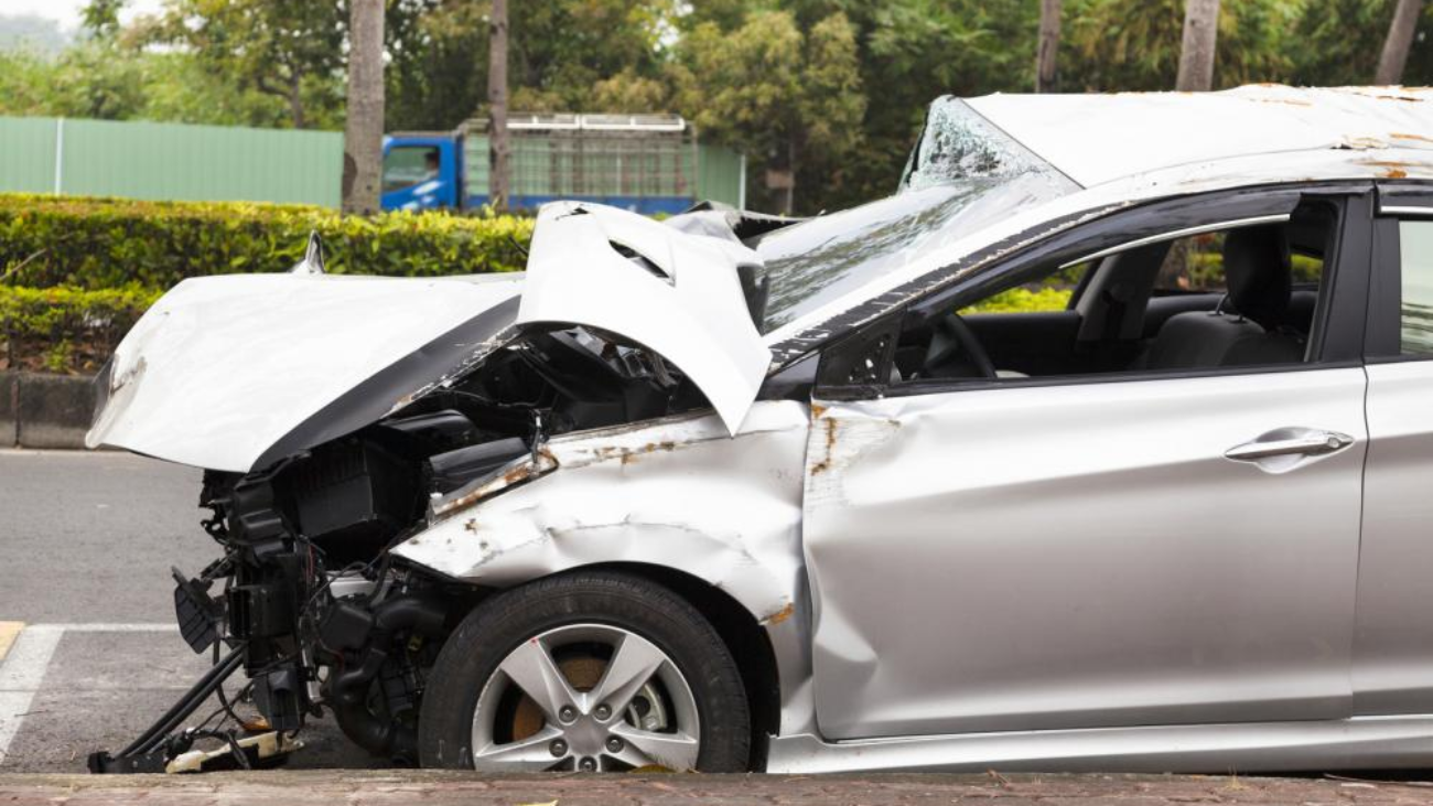 A damaged car after an accident on the road.