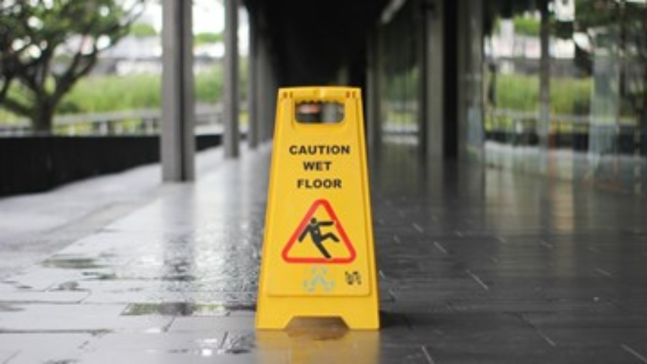 Wet floor sign on a mopped floor.