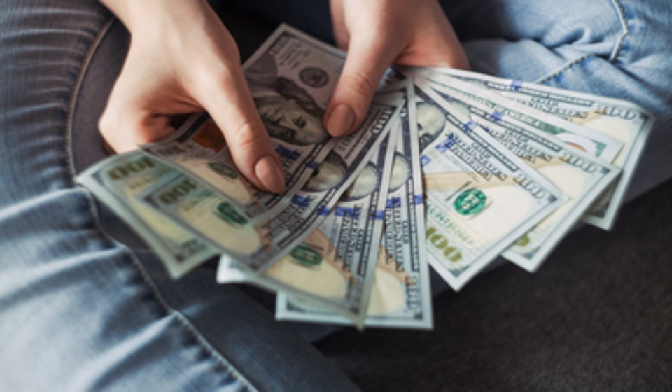 a person holding cash