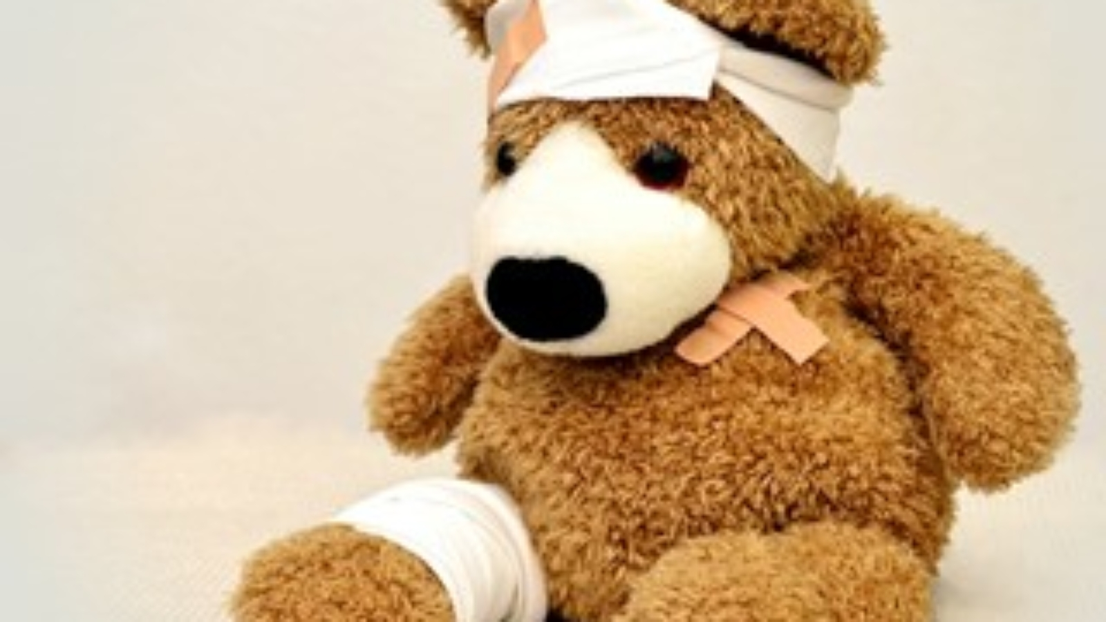 A teddy bear with injuries